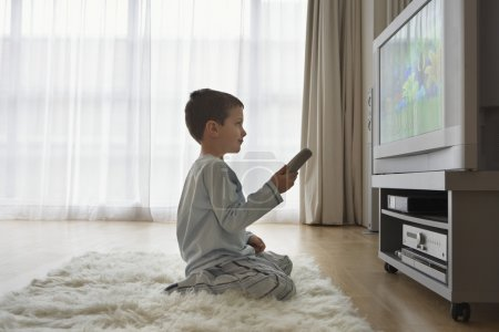 Boy on floor  watching  television