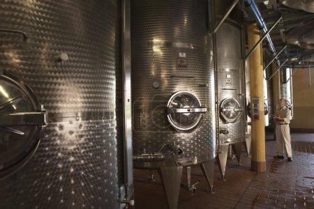Winemaker with Wine Vats