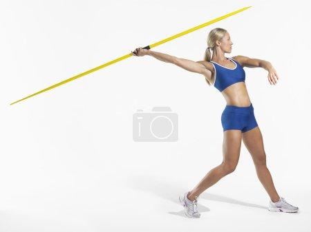 Female athlete throw javelin