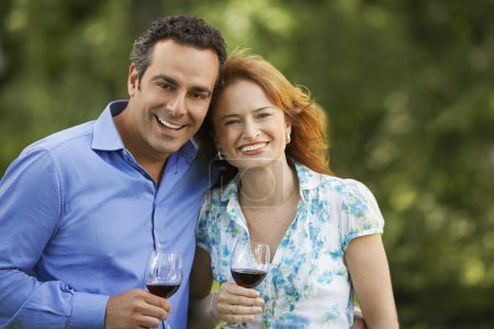 Photo for Couple Drinking Wine in back yard portrait - Royalty Free Image