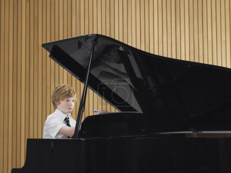 Photo for High School Student Practicing Piano - Royalty Free Image