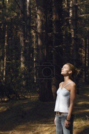 Worried woman in woods