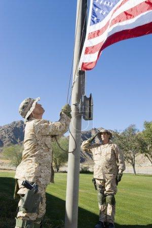 Soldiers raising United States flag
