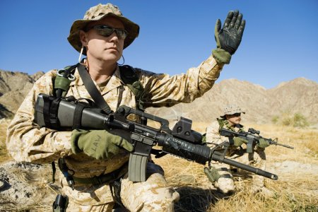 Soldier with weapon signaling