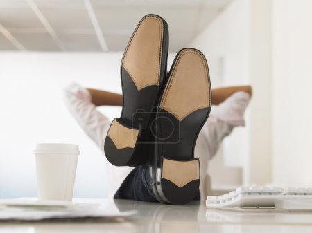 Businessman with Feet Up