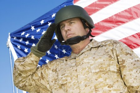 Photo for Soldier saluting in front of United States flag - Royalty Free Image