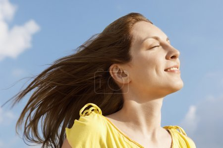 Woman enjoying wind on face