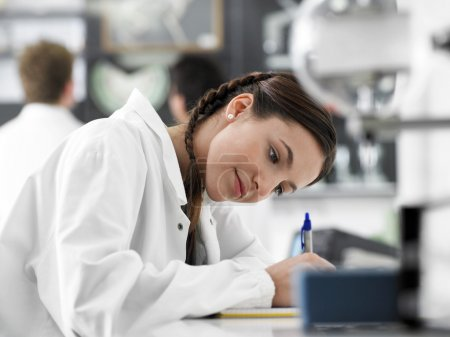 High School female  Student  with microscope