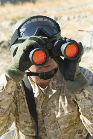Photo for Soldier using binoculars outdoors - Royalty Free Image