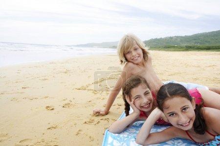 Children reclining hand on cheek