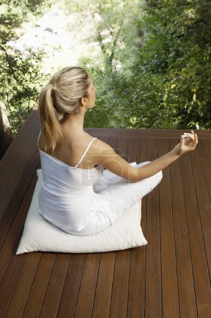 Woman meditating outdoor