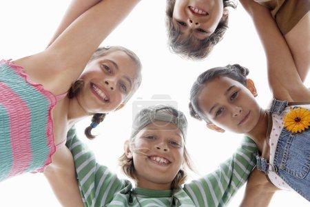 Children Huddling in a Circle