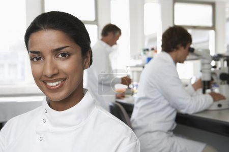 Photo for Smiling Lab Worker colleagues behind - Royalty Free Image