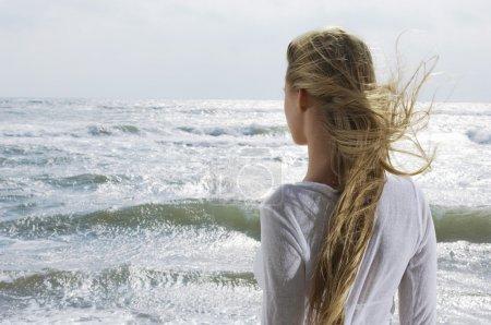 Woman Looking at Ocean