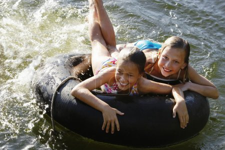 cheerful Girls with Float Tube