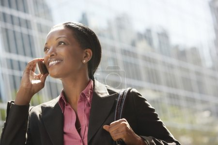 African American businesswoman using mobile phone