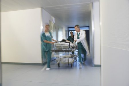 Doctors running Patient on gurney