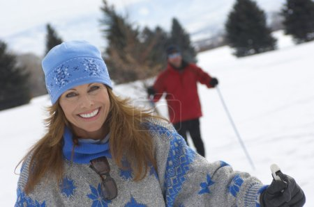 Woman cross country skiing with man
