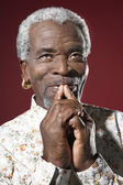 African Man with Fingers on Mouth