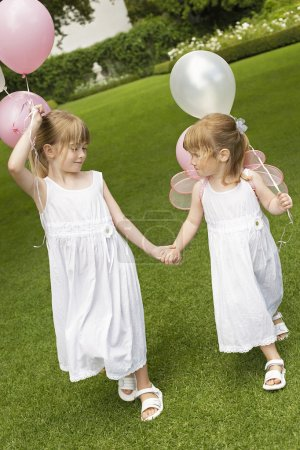Sisters with balloons