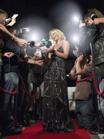 Photo for Woman signing autographs on red carpet - Royalty Free Image