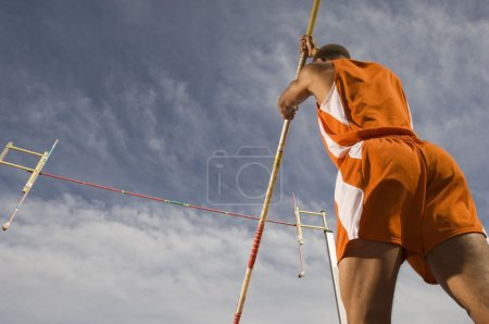 Pole vaulter preparing for a jump