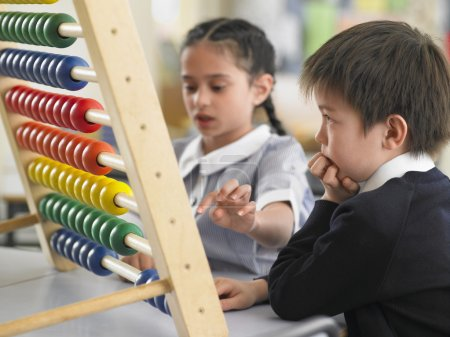 Elementary students using abacus