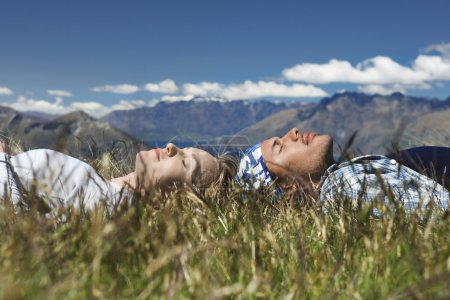 Man and woman lying in field