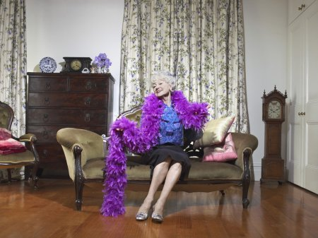 Senior woman wearing feather boa