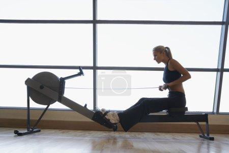 Women Using Rowing Machine