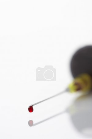 Blood droplet on syringe