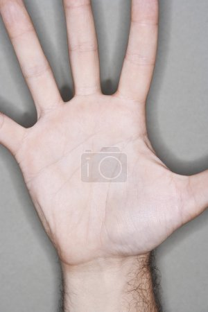 Man displaying outstretched hand