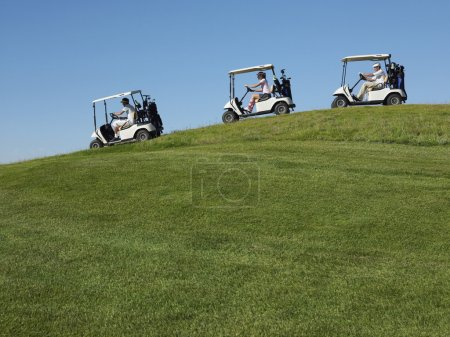 Golfers Driving Carts