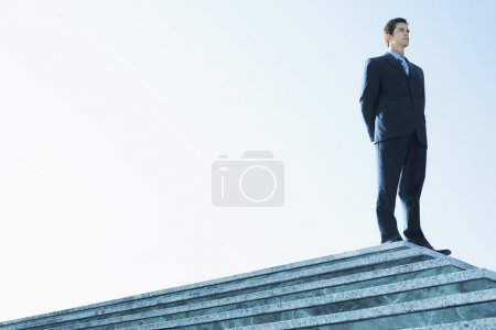 Businessman Standing on marble platform