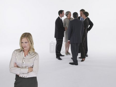 Executives in group with businesswoman