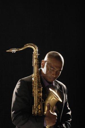 Man holding saxophone
