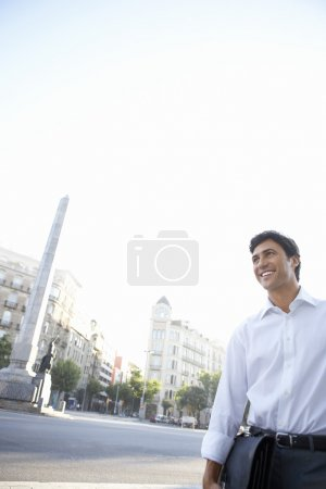 Businessman holding briefcase by