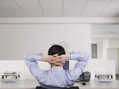 Office worker relaxing at desk