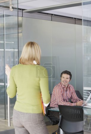Photo for Two office workers talking in office - Royalty Free Image