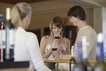 Woman Smelling a Glass of Wine