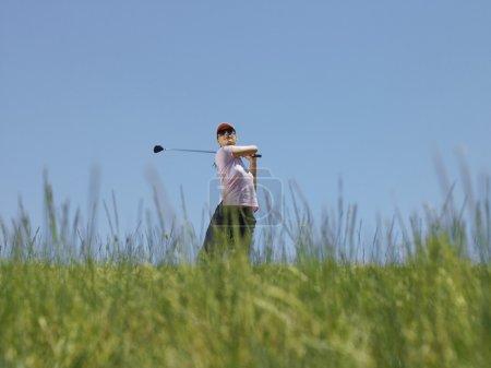 Golfer Driving Ball