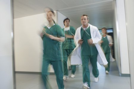 Doctors and nurses in scrubs running