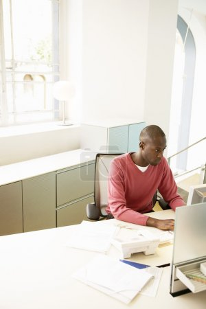 african american office worker with computer