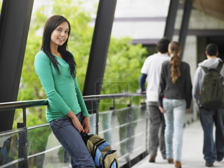 Photo for Young Woman Leaning Against a Railing - Royalty Free Image
