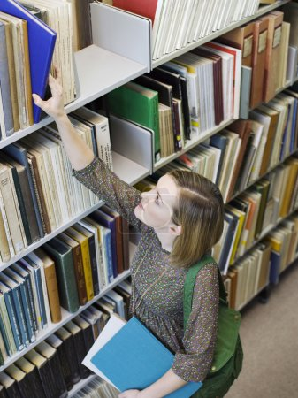 woman reaching for book
