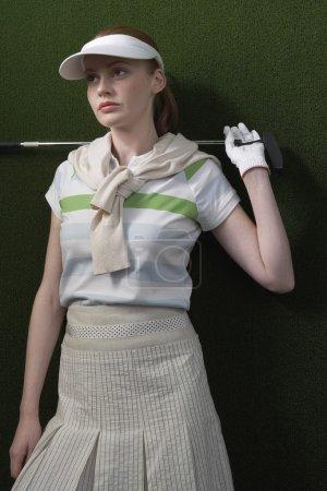 female golfer with  golf club