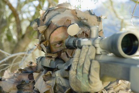 Photo for Soldier aiming through gunsight outdoors (close-up) - Royalty Free Image