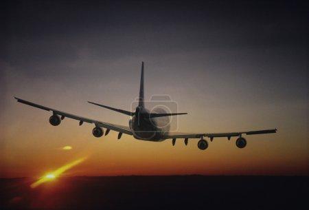 Plane Flying sun