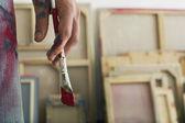 Artist holding paint brush