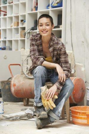 female Sculptor in Studio